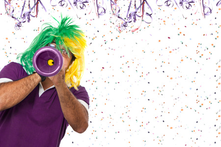 vuvuzela: Brazilian guy blowing vuvuzela at Carnival time Stock Photo
