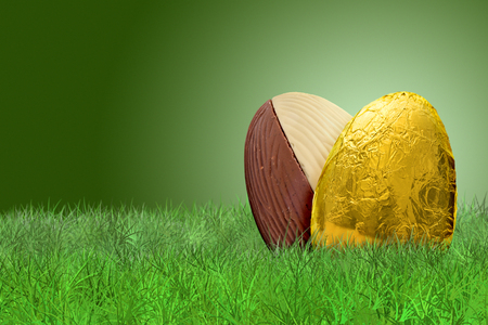 golden background: Golden Easter egg and double taste Easter egg on on grass on green background Stock Photo