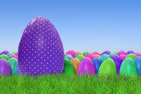 grass background: Happy Easter and dotted Easter Eggs on clear sky background Stock Photo