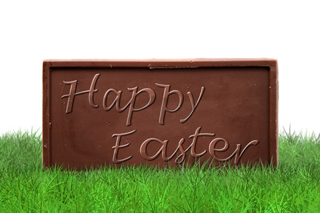 brown background: Happy Easter text on chocolate bar on white background