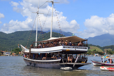 schooner: Paraty, Rio de Janeiro, Brazil - Jan 13, 2016: People going to a ride on a schooner to know areas in Paraty, Rio de Janeiro, Brazil. Editorial