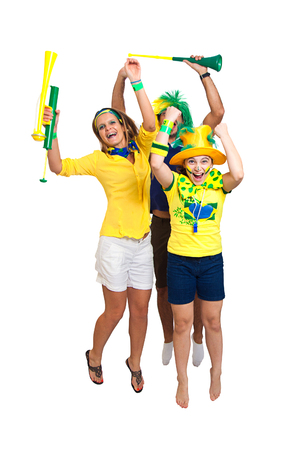 Brazilian fa,ily fans celebrating jumping and cheering on white background Foto de archivo