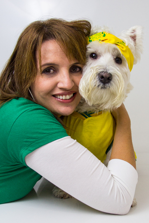 Brazilian woman and her west highland white terrier wearing a Brazilian team t-shirt