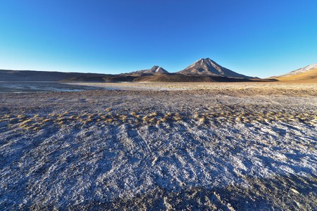 tantrums: Volcanoes seen from Lake Lejia, Atacama desert, Chile. Stock Photo