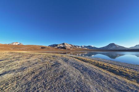tantrums: Lake Lejia with tantrums, Lascar, Calientes and Acamarachi Aguas volcanoes in the background. Stock Photo