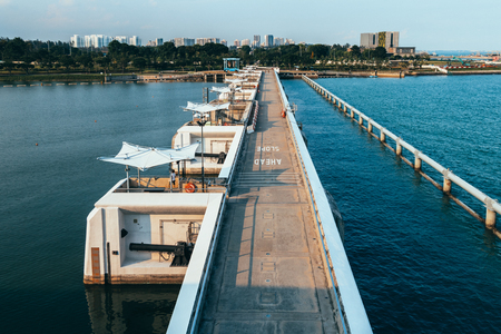 Water dam separating calm and rough water at Marina Barrage, Singapore Stock Photo