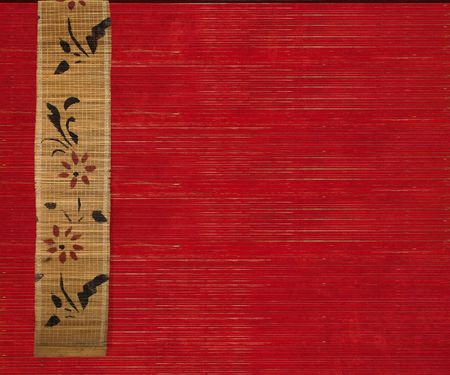 Flower bamboo banner on red ribbed wood background photo