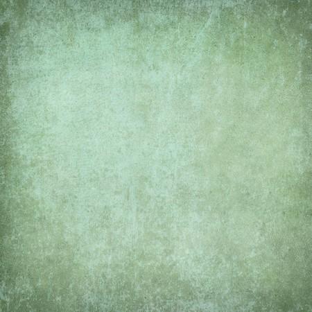 Green grunge plaster or paper textured background photo