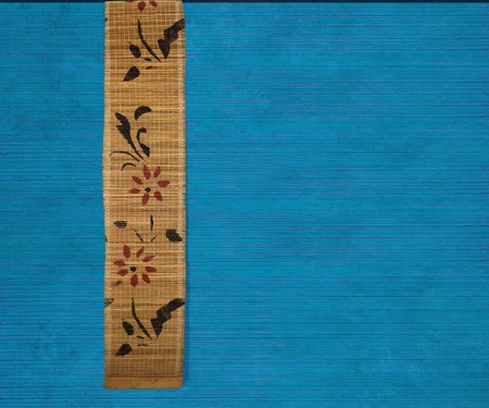 Flower bamboo banner on blue ribbed wood textured background photo