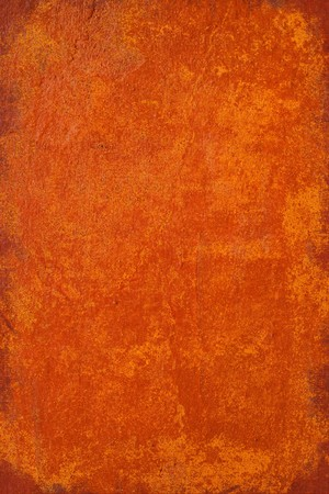 Burnt orange grunge plaster background with frame Stock Photo