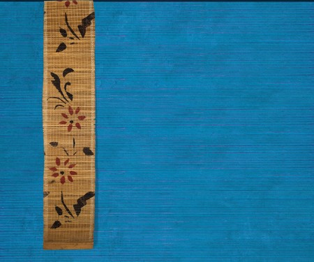Flower bamboo banner on blue ribbed wood background  photo