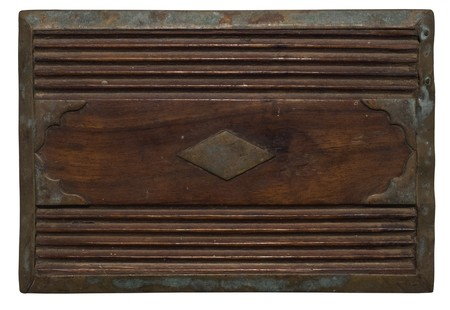 Carved wooden panel with distressed stained metal isolated  photo