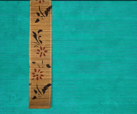 Flower bamboo banner on aquamarine ribbed wood textured background photo