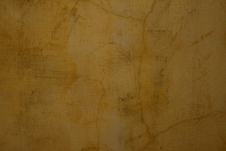 Honey colored cracked plaster wall textured background photo