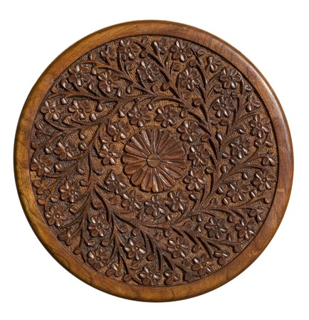 Carved circular wood panel with floral design isolated  photo