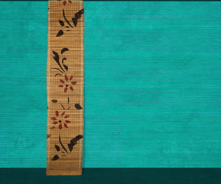 Flower bamboo banner on aquamarine ribbed wood background photo