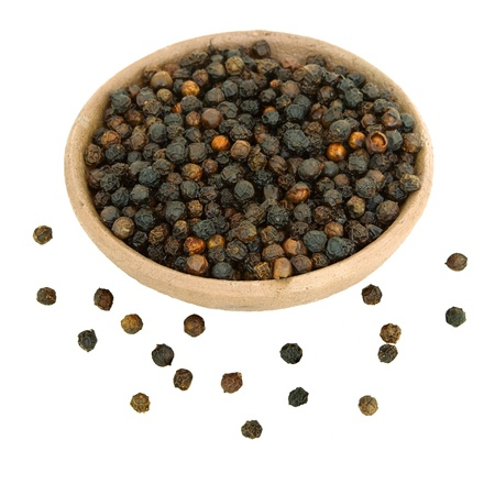 Black Peppercorns in a handmade clay bowl isolated with clipping path 