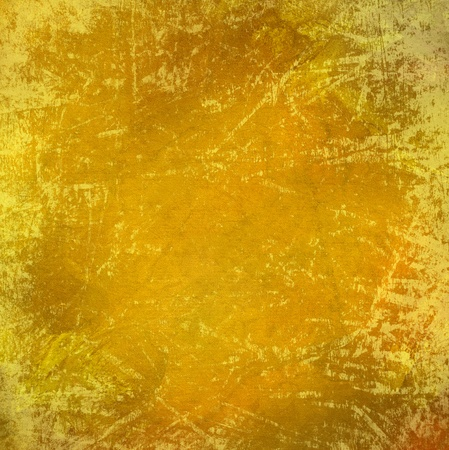 Scratched grungy yellow highly textured abstract background photo