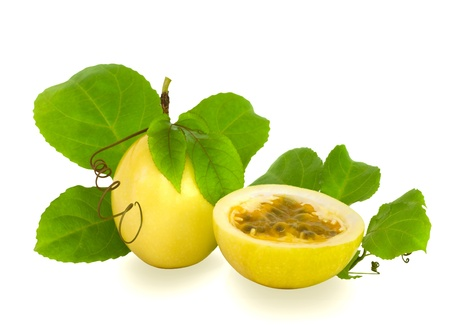 Cut and Complete Passion Fruit with Vine leaves and Coil Isolated photo