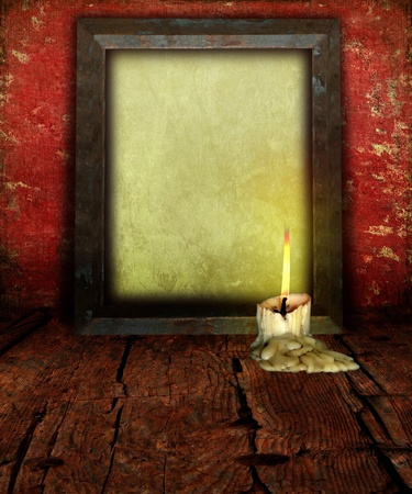 moody: Candle Stubb and Empty Picture Frame on rustic moody background