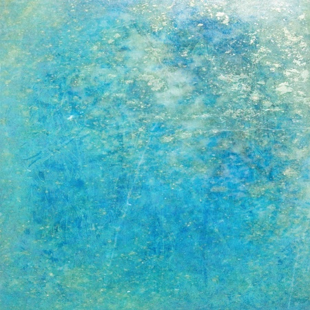 Image of a Glistening Turquoise grunge Textured Background photo
