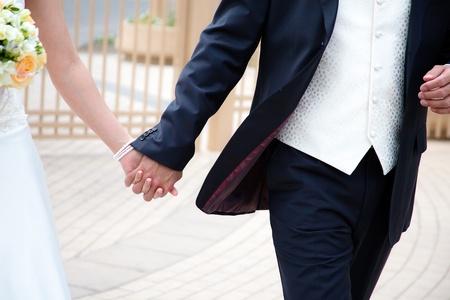 Wedding couple hands, wedding bouqet, groom, bride