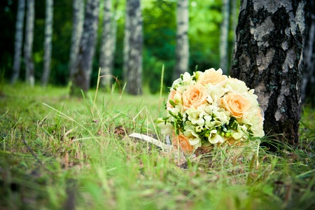 Wedding bouquet in the grass in the forest