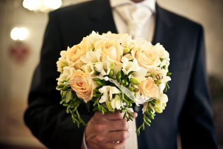 Wedding bouquet in groom