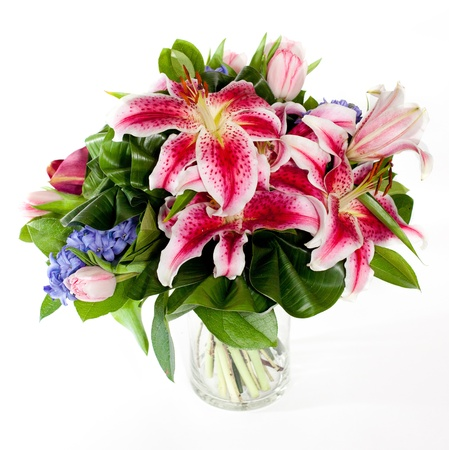 bouquet of lily flowers in glass vase