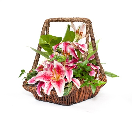Flower composition with lilies in basket Stock Photo - 10346306