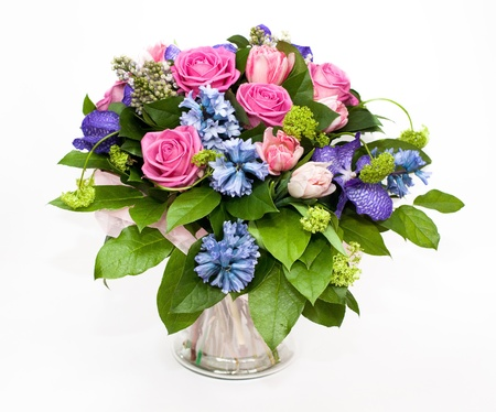 bouquet of lilas and roses in glass vase