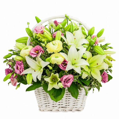 flowers bouquet: flower composition in basket isolated on white background Stock Photo
