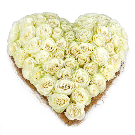 composition of white roses in the shape of heart