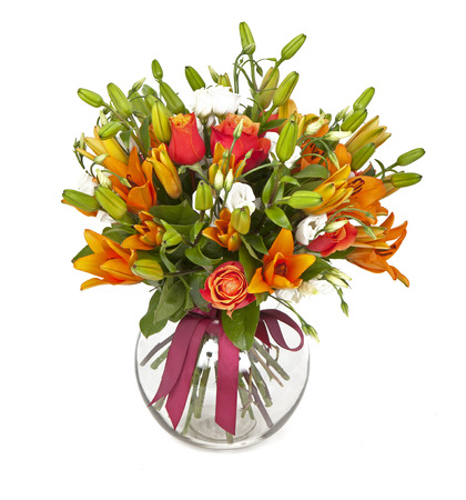 bouquet of orange lilias and roses in vase isolated on white