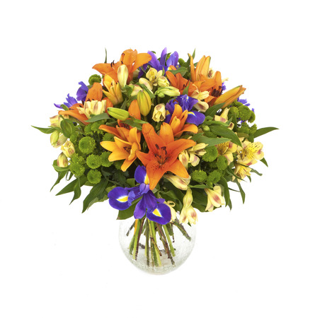bouquet of orange lilias and irises in vase isolated on white
