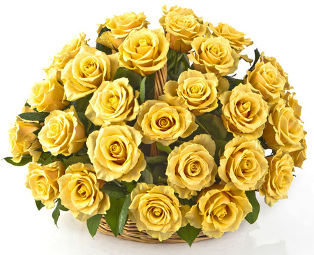 bouquet of yellow roses  in basket  on white background Stock Photo