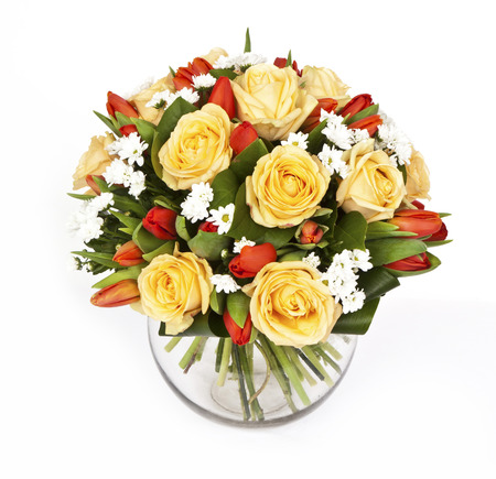 bouquet of yellow roses and red tulips in vase isolated on white background Zdjęcie Seryjne