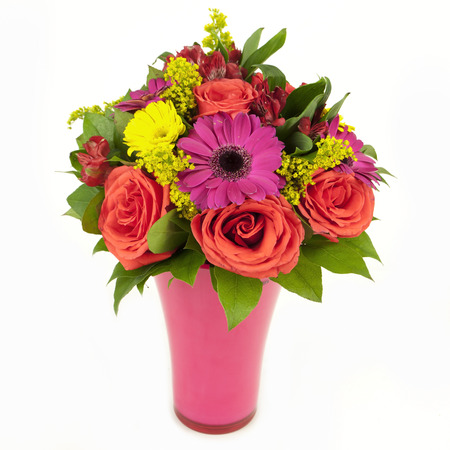bouquet of pink and yellow flowers in vase isolated on white