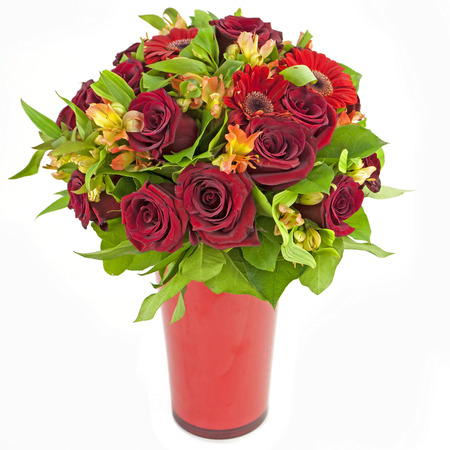 bouquet of red roses  and gerberas in vase isolated on white