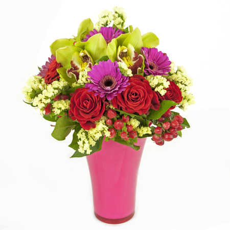 bouquet of orchids, roses and gerberas in vase isolated on white