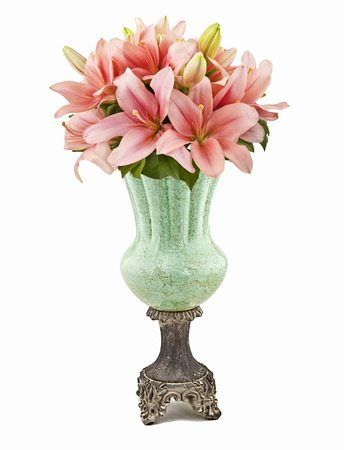 bouquet of pink lilies in vase isolated on white