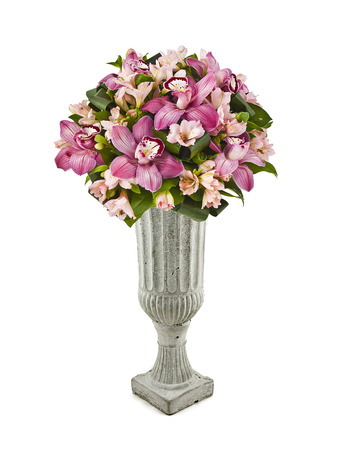 bouquet of pink orchids in vase isolated on white