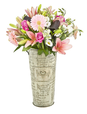 bouquet of pink flowers in metal vase isolated on white