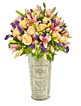 bouquet of orange and pink flowers in metal vase isolated on white