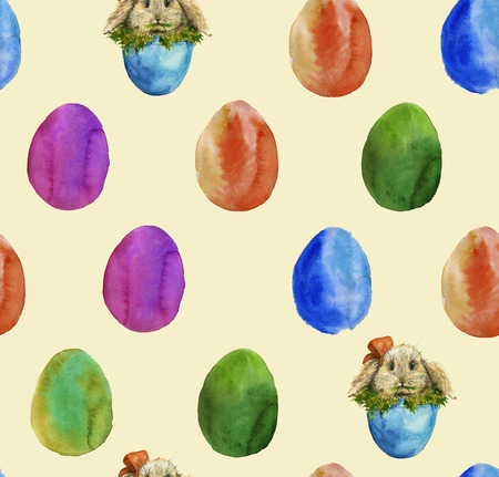 munching: the background of the colored Easter eggs and eggs with the Easter Bunny, munching grass. Watercolor