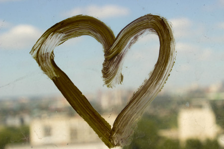 yellow heart: Yellow heart on the city background