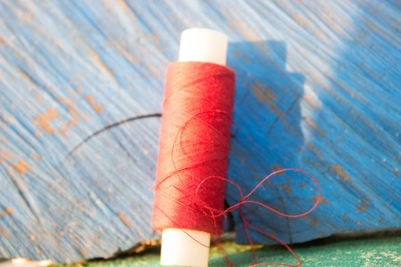 to scrape: red strings on the old wooden textures Stock Photo