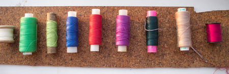 to scrape: a bunch of colorful yarn lying in a row