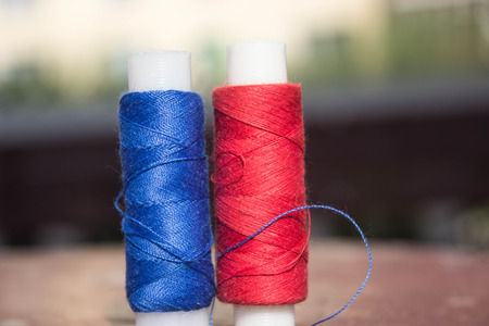 red and blue thread on the table Stock Photo
