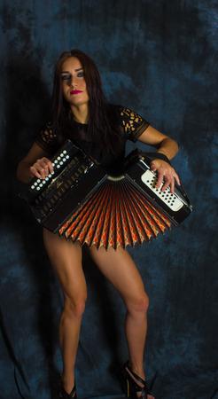 Beautiful sexy girl on the background of stylish eve fashion